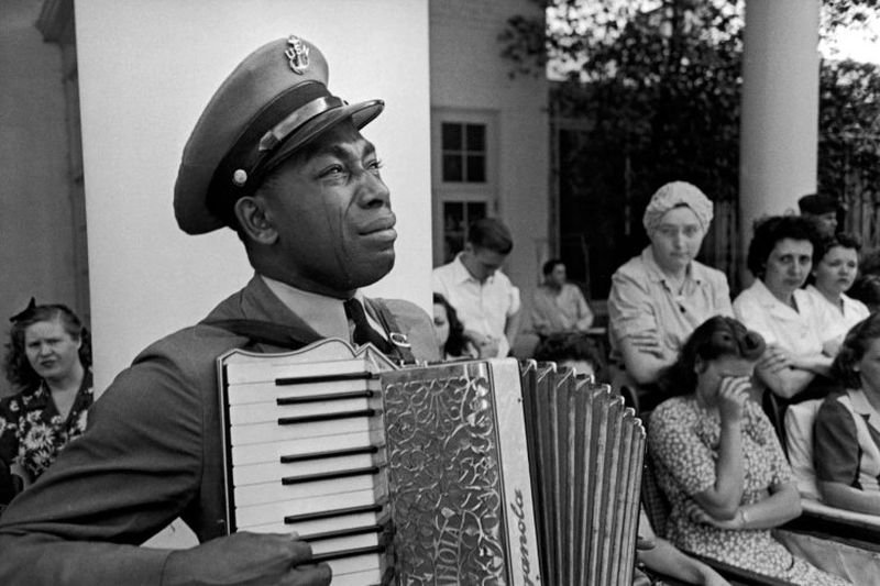 12. The LIFE magazine photo of U.S. Navy Officer Graham Jackson, a friend of President Roosevelt, playing at his funeral April, 1944.