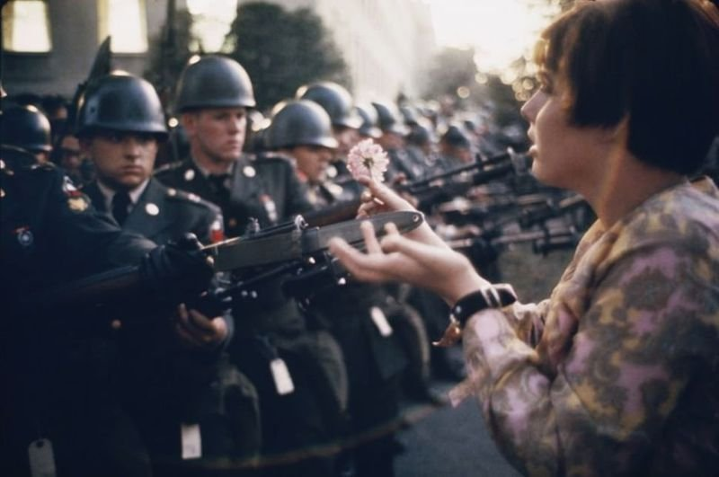 2. A 17-year-old girl offers a flower to a soldier during the Pentagon Anti-War Protest in October, 1967.