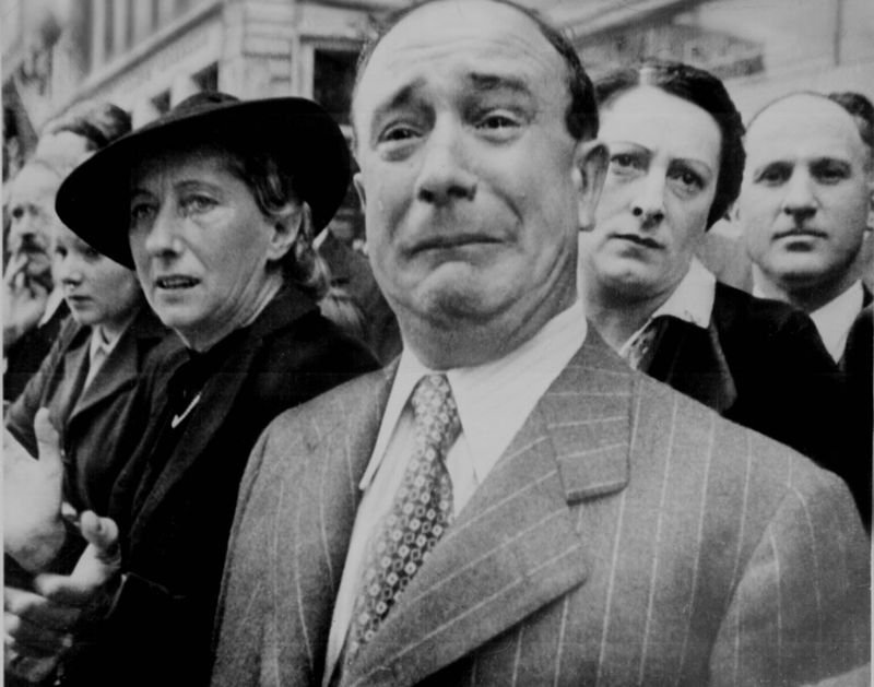 23. A French citizen cries as the Nazis occupy Paris during the IInd World War.