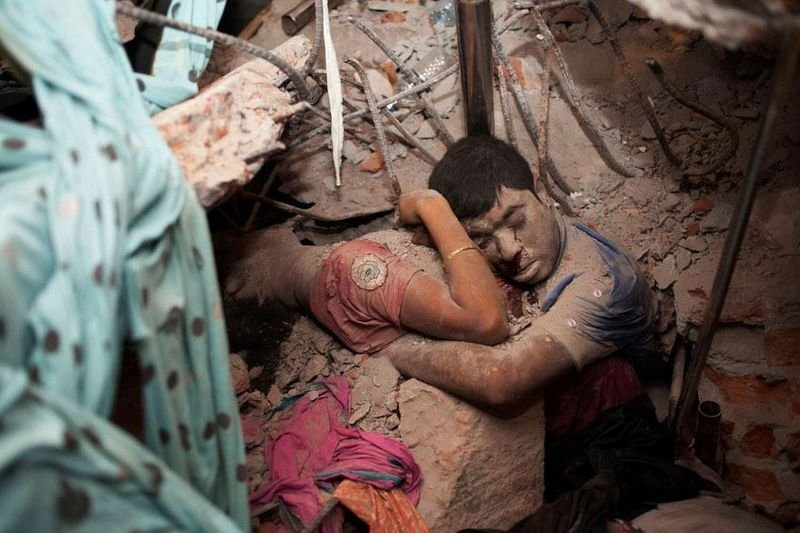 26. The final embrace of a couple that died after a factory collapsed in Bangladesh.