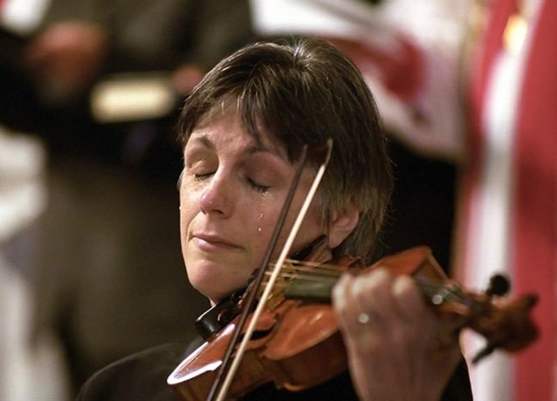 28. A violinist cries while playing at a 9/11 memorial service in Vancouver.