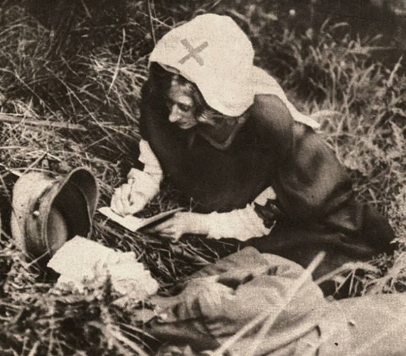33. A Red Cross nurse writes the last words of a British soldier during WWI.