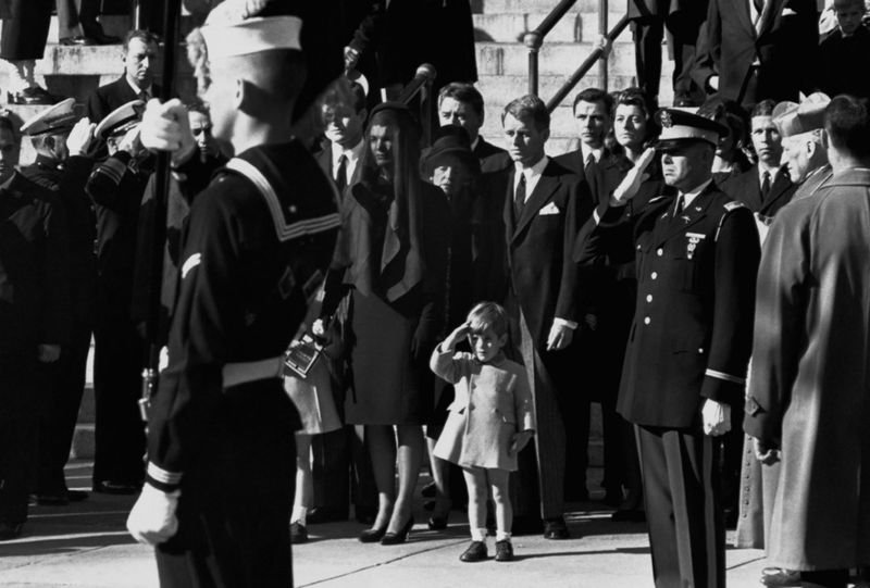 8. John F Kennedy Jr. at his father's funeral, saluting his coffin. JFK was assassinated on 22nd November, 1963.