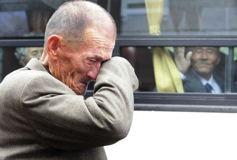9. A South Korean cries as a North Korean relative waves goodbye. A temporary 3-day family reunion was allowed after 60 years between families from across the border in October, 2010.