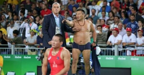 Angry Mongolian Wrestling Coaches Strip Down To Challenge