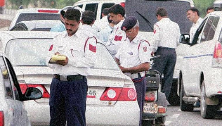 Traffic policemen issuing challans