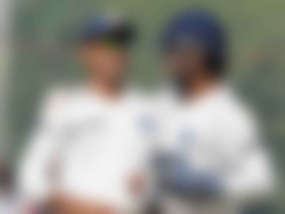 Sourav Ganguly and MS Dhoni during a Test match