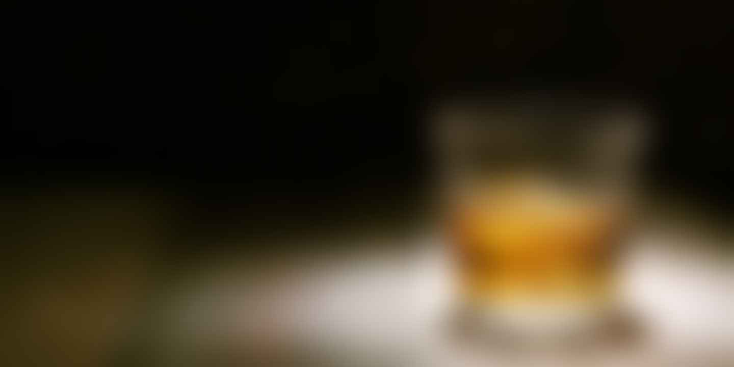 Glass filled with whiskey and ice
