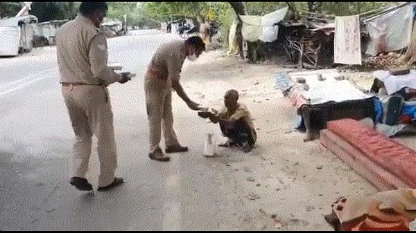 police feeding the poor
